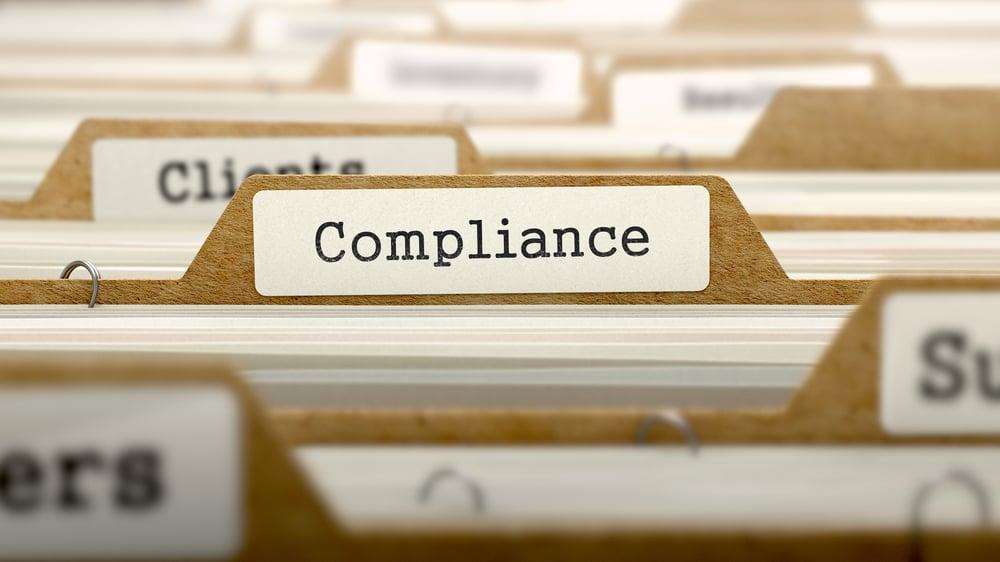 Compliance Concept. Word on Folder Register of Card Index. Selective Focus.